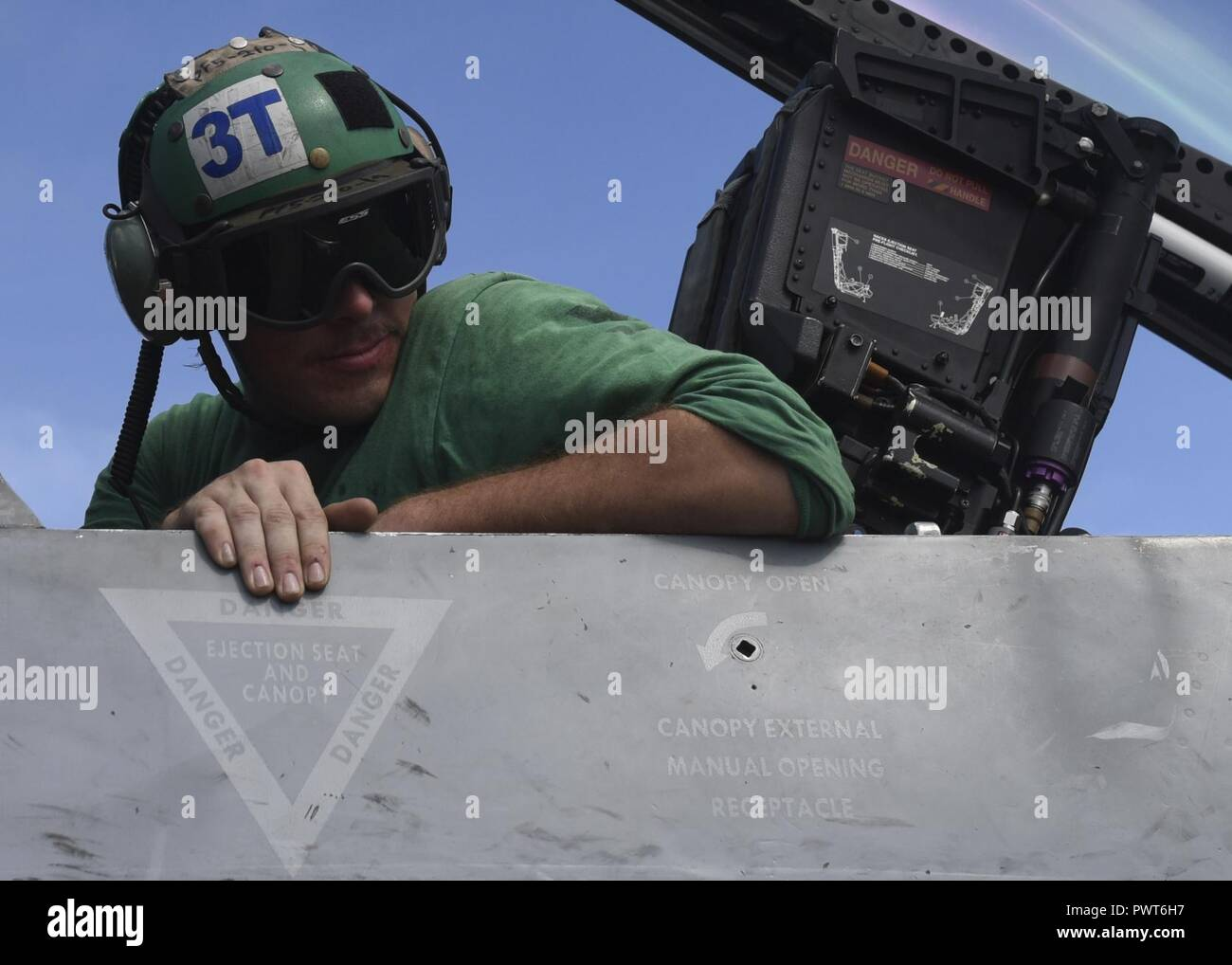 WATERS OFF GUAM (July, 1 2017) U.S. Navy Aviation Electronics Technician 3rd Class Nick Mendenhall, a native of Paso Robles, Calif., performs a visual inspection on a F/A-18 E Super Hornet from the 'Blue Diamonds' of Strike Fighter Squadron (VFA) 146 aboard the aircraft carrier USS Nimitz (CVN 68), July 1, 2017, in the Pacific Ocean. Nimitz is currently on deployment in the U.S. 7th Fleet area of operations. The U.S. Navy has patrolled the Indo-Asia Pacific routinely for more than 70 years promoting regional peace and security. ( - Stock Image