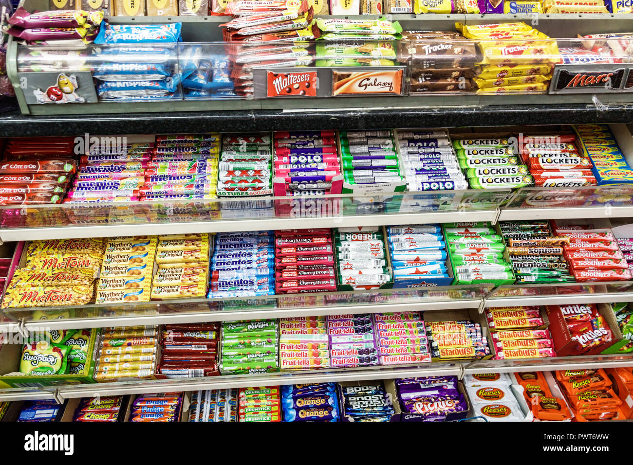 London England United Kingdom Great Britain Lambeth market grocery convenience store display breath mints gum chocolate candy Mentos Polo shelves disp - Stock Image