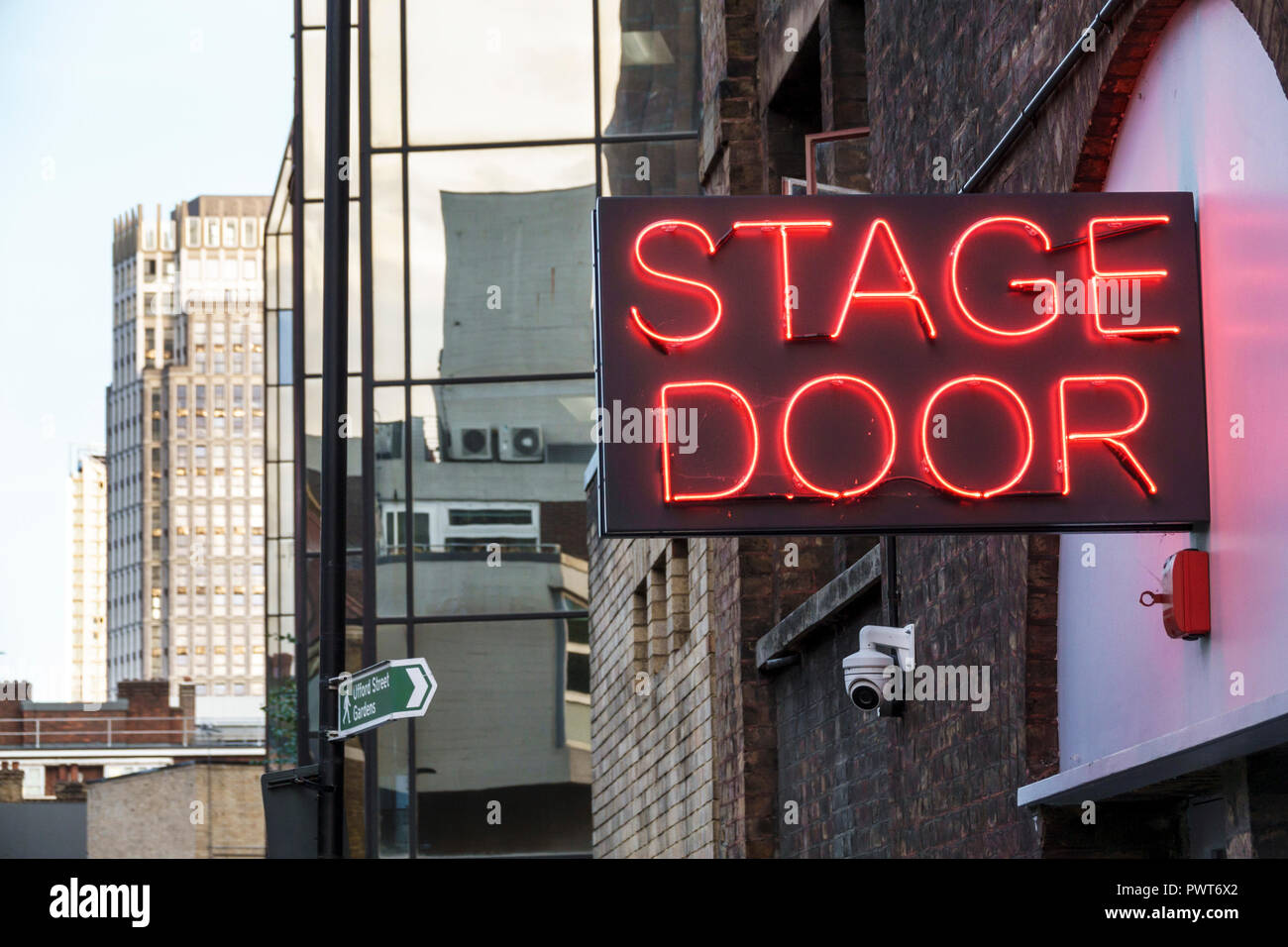 London England United Kingdom Great Britain Lambeth Waterloo The Old Vic theatre theater exterior historic building Stage Door neon sign - Stock Image