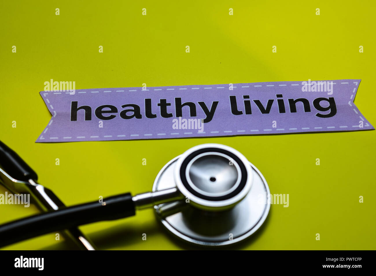 healthy living with stethoscope concept inspiration on yellow background - Stock Image