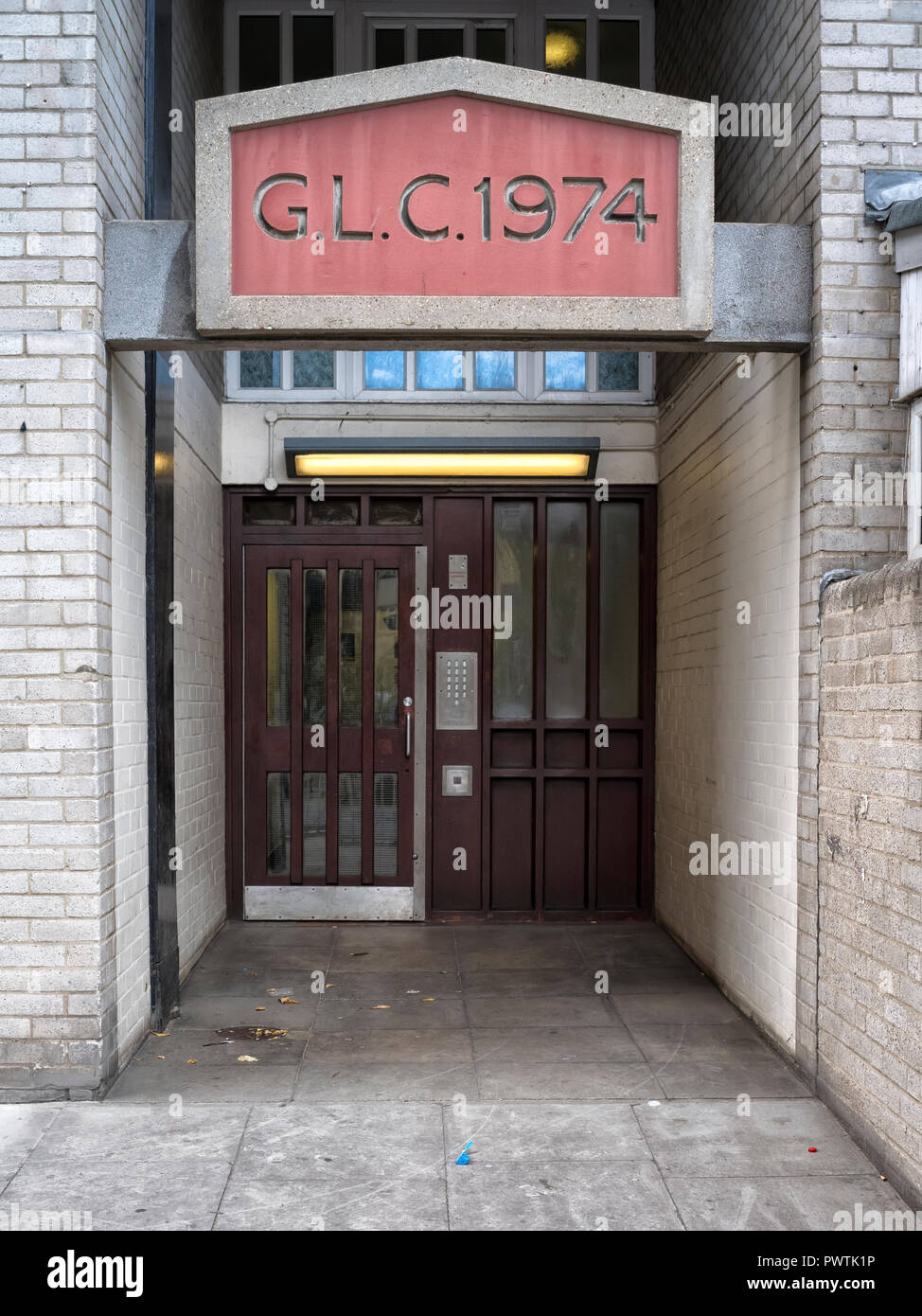 Entrance to local authority flats in Hanbury Street, Whitechapel with the legend GLC 1974 above the entrance - Stock Image
