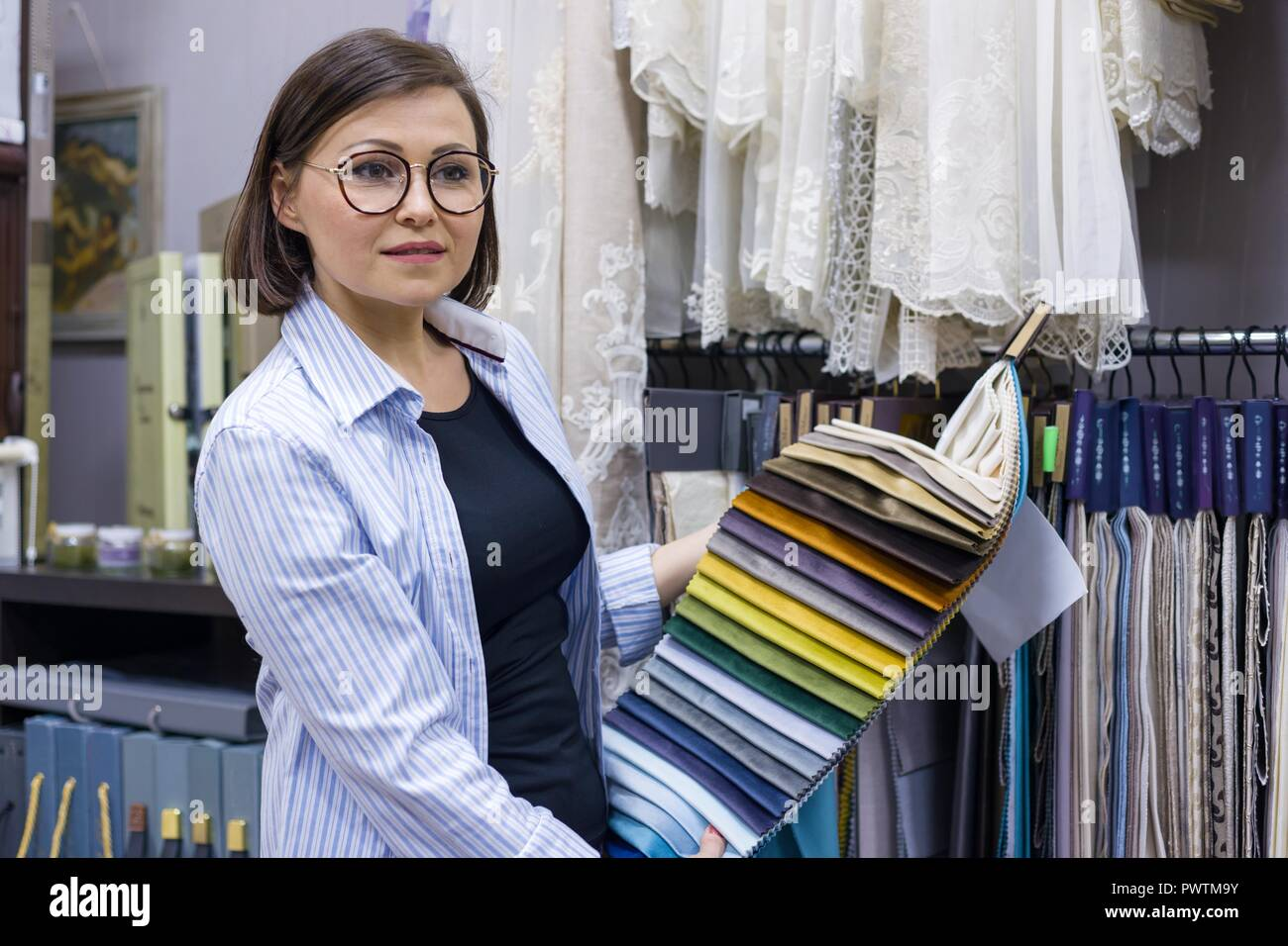 Female Designer Interior Decorator Store Owner Shows The Fabric Small Business Textile Shop Stock Photo Alamy