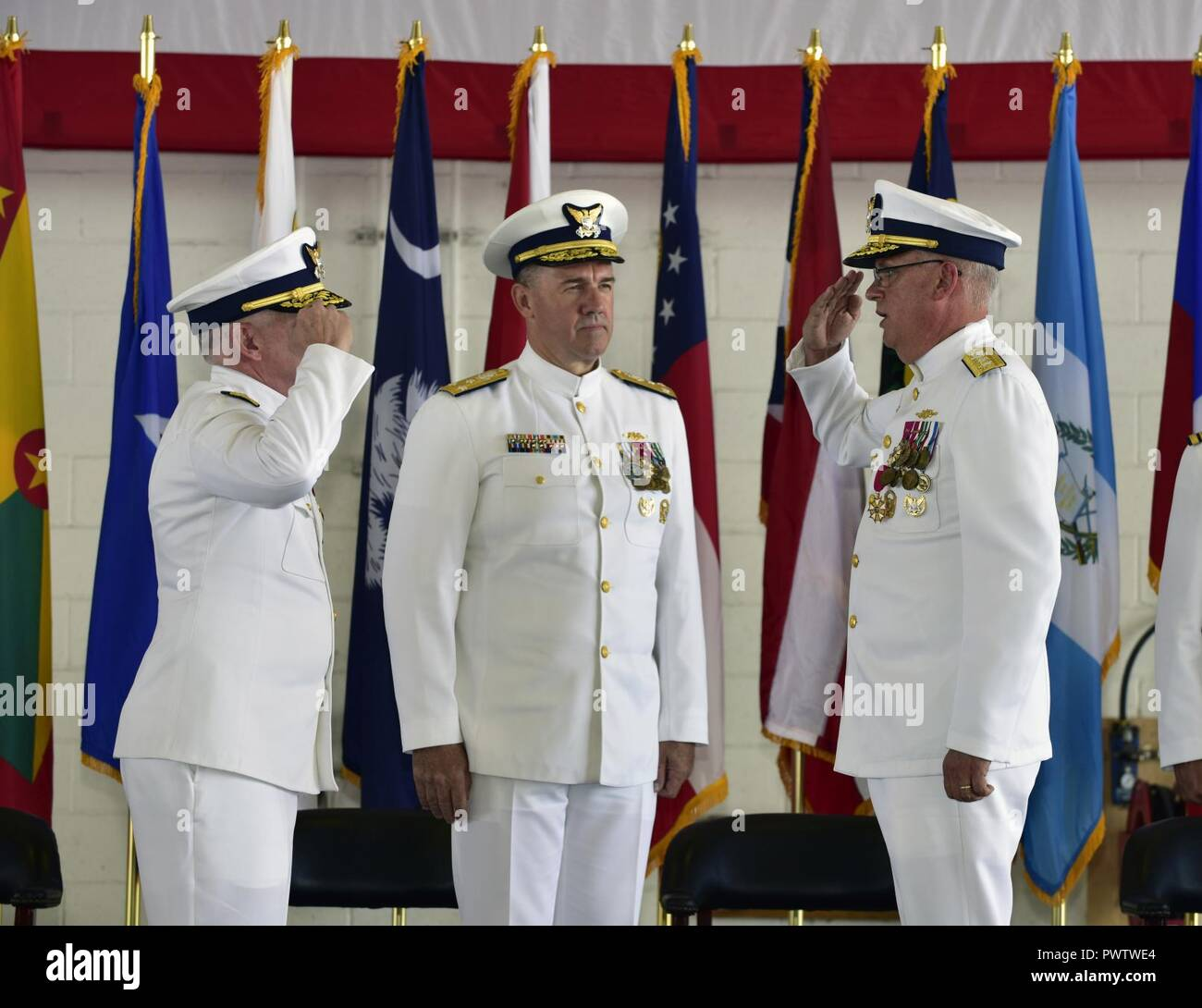 The Coast Guard Rear Adm. Scott A. Buschman passes command of the Seventh District to Rear Adm. Peter J. Brown during the Change of Command Ceremony at Air Station Miami on June 23, 2017. Stock Photo