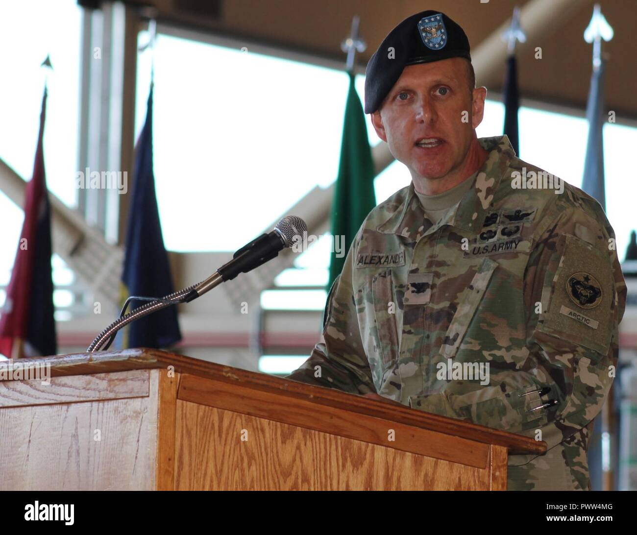 Outgoing U.S. Army Alaska Aviation Task Force Commander Col. Blake Alexander thanks USARAK and Fort Wainwright key leaders and staff members, as well as leaders from the civilian community June 29 at the UATF change of command at Fort Wainwright, Alaska. Stock Photo