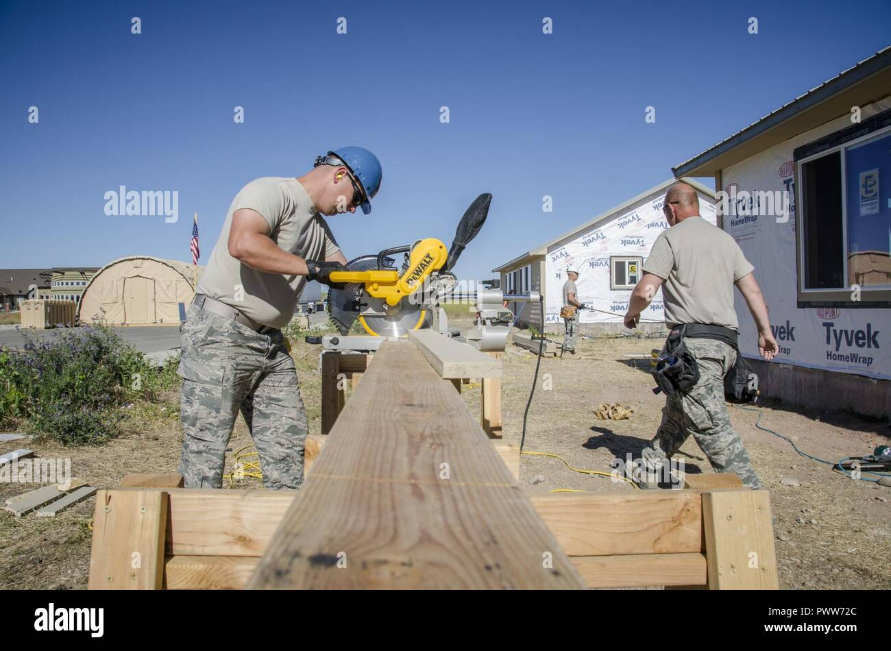 U.S. Air Force Senior Airman Richard Green, an Airman with the 128th Air Refueling Wing Civil Engineer Squadron, Wisconsin Air National Guard, operates a miter saw to make cuts to siding June 22, 2017, at the Crow innovative readiness training construction site. The Crow IRT is a deployment for training opportunity that provides training and readiness for military personnel while addressing public service needs. Stock Photo