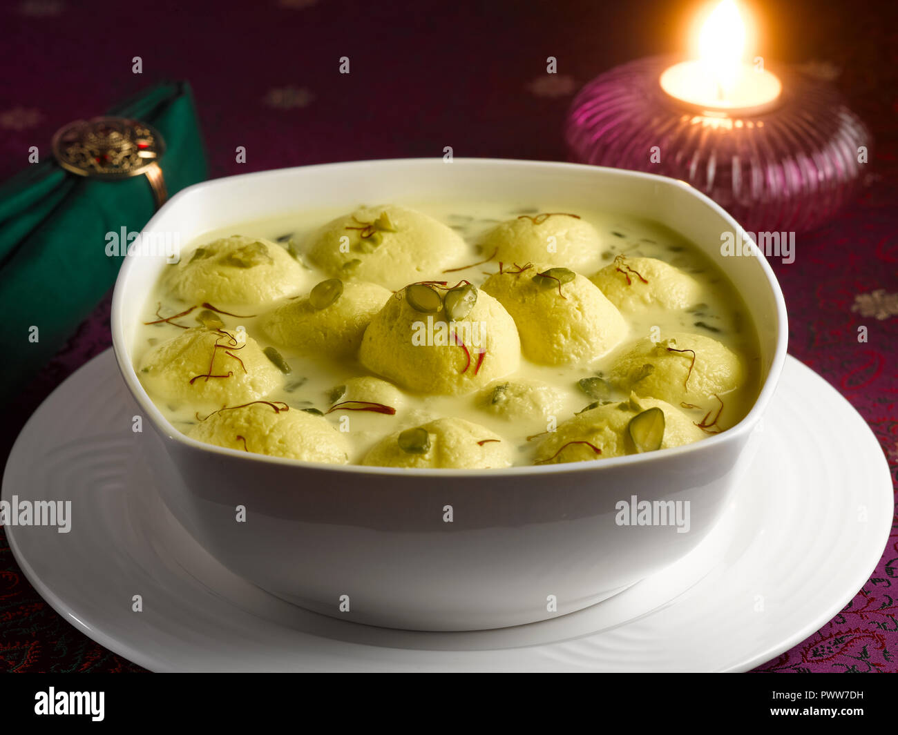 RASMALAI, AN INDIAN DESSERT MADE FROM COTTAGE CHEESE SOAKED IN SWEET SAFFRON MILK AND GARNISHED WITH PISTACHIO Stock Photo