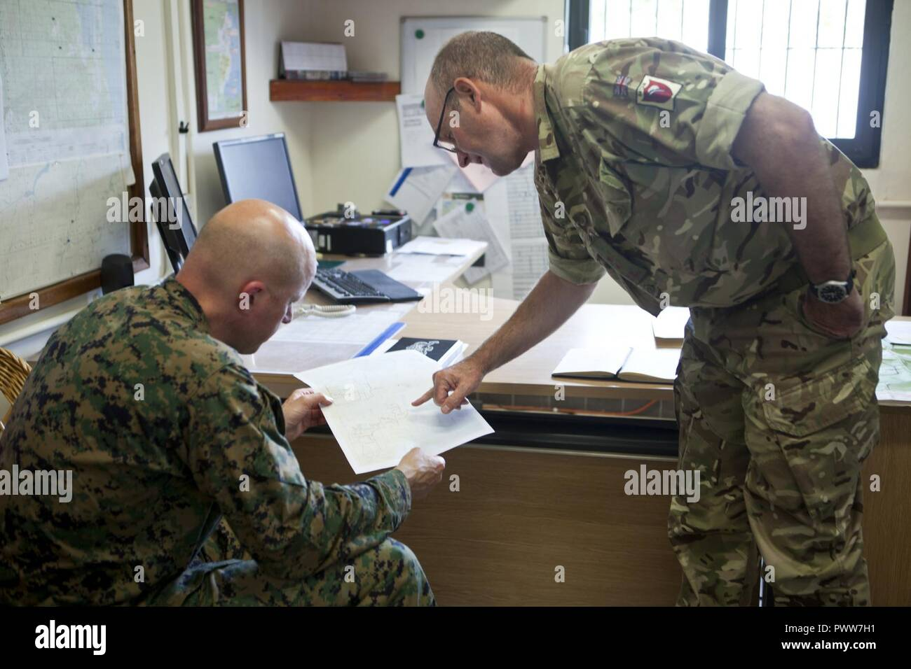 U.S. Marine Col. Michael V. Samarov, the commander of Special Purpose Marine Air-Ground Task Force - Southern Command, meets with British Army Lt. Col. Simon Walton, British Army Training Support Unit Belize at Price Barracks in Ladyville, Belize, June 21, 2017. Samarov visited elements of his unit and met with various key leaders during his circulation to different countries in Central America in which SPMAGTF-SC is operating. The Marines and sailors of SPMAGTF-SC are deployed to Central America for the next six months to conduct security cooperation training and engineering projects with the - Stock Image