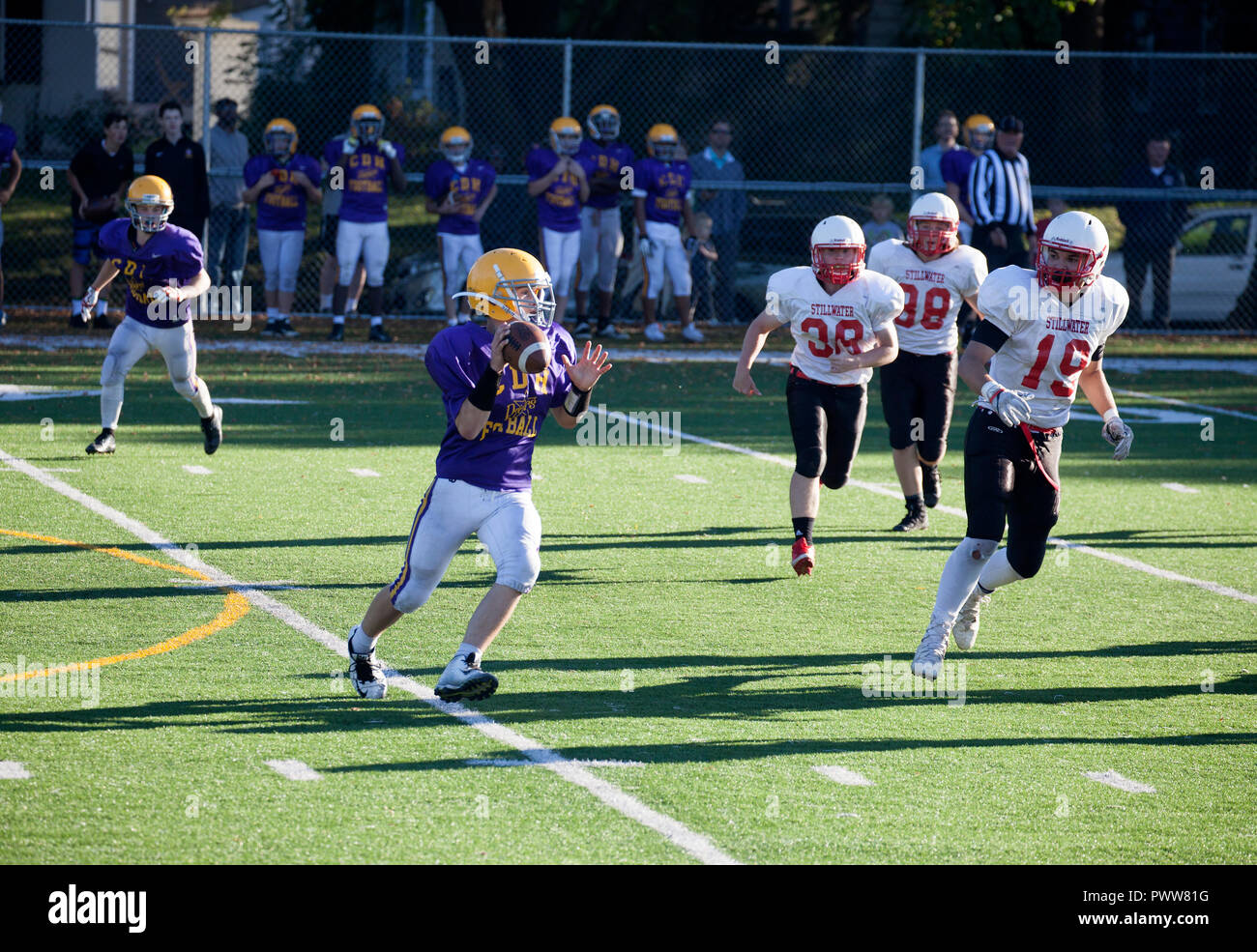Cretin-Durham Hall High School quarterback runs a bootleg pass against Stillwater High School. St Paul Minnesota MN USA - Stock Image