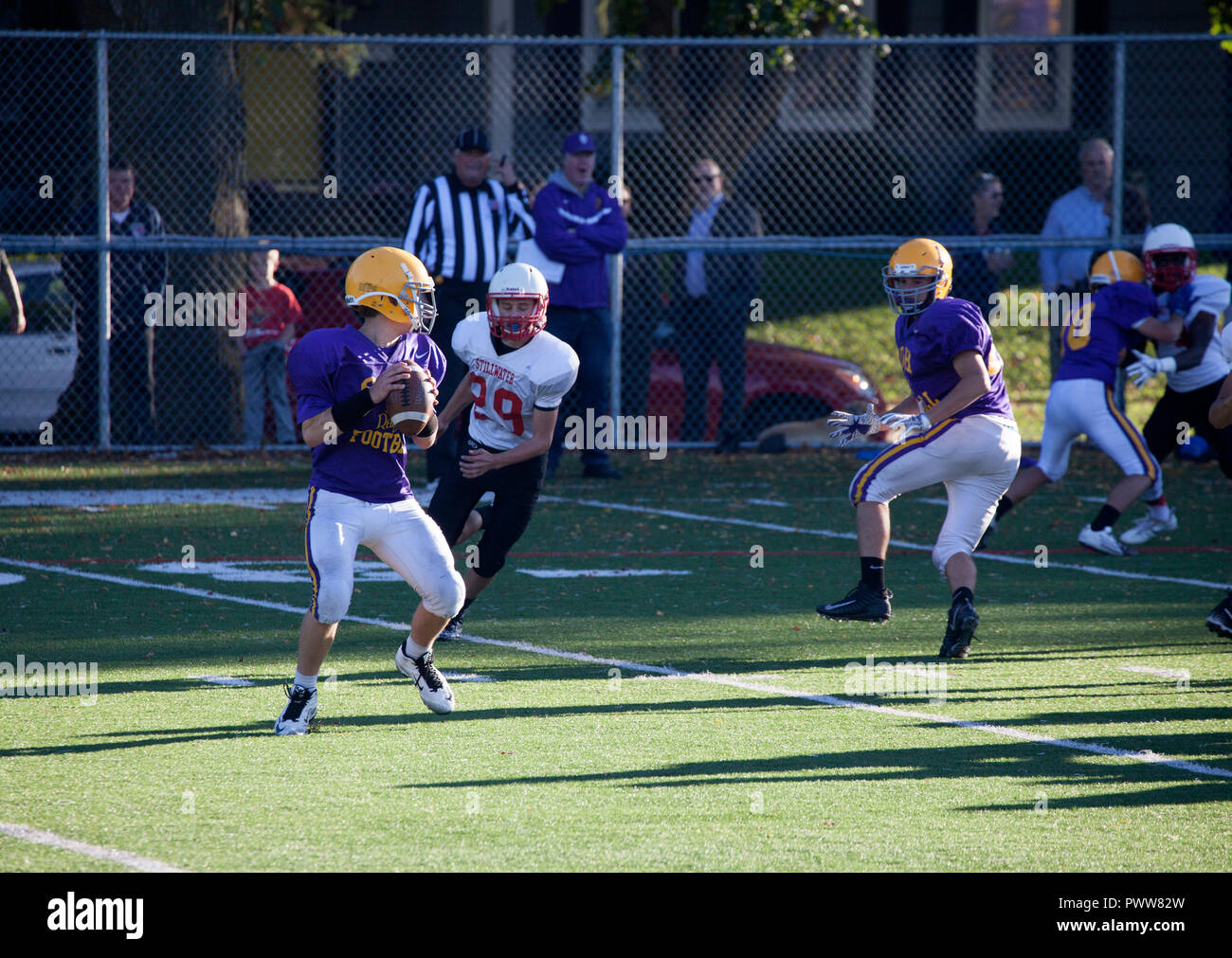 Cretin-Durham Hall High School quarterback passes football just over the line of scrimmage against Stillwater High School. St Paul Minnesota MN USA - Stock Image