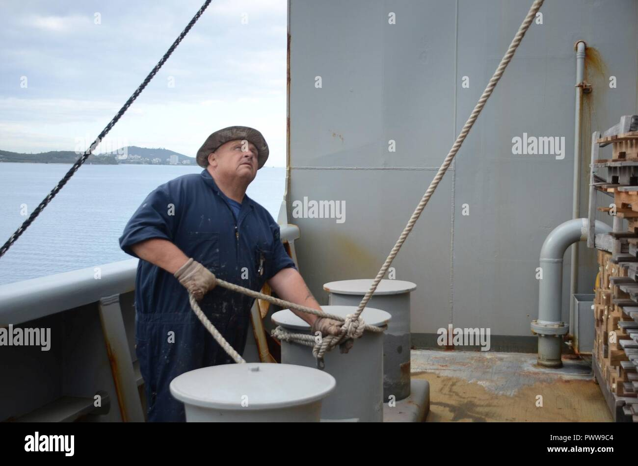 NOUMEA, New Caledonia (July 03, 2017) Robert Moore, Able-Bodied Seaman (maintenance) onboard USNS Sacagawea (T-AKE 2), assists in lift operations off shore Noumea, New Caledonia in support of Koa Moana 17, July 3. Koa Moana 17 is designed to improve theater security, and conduct law enforcement and infantry training in the Pacific region in order to enhance interoperability with partner nations. ( Stock Photo
