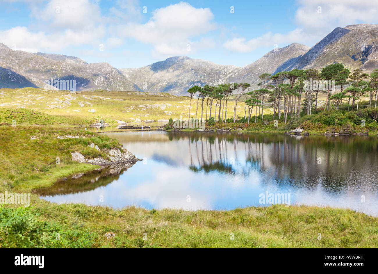 A mountainous landscape reflected in Derryclare Lough, in the Inagh Valley, County Galway, Ireland. Stock Photo