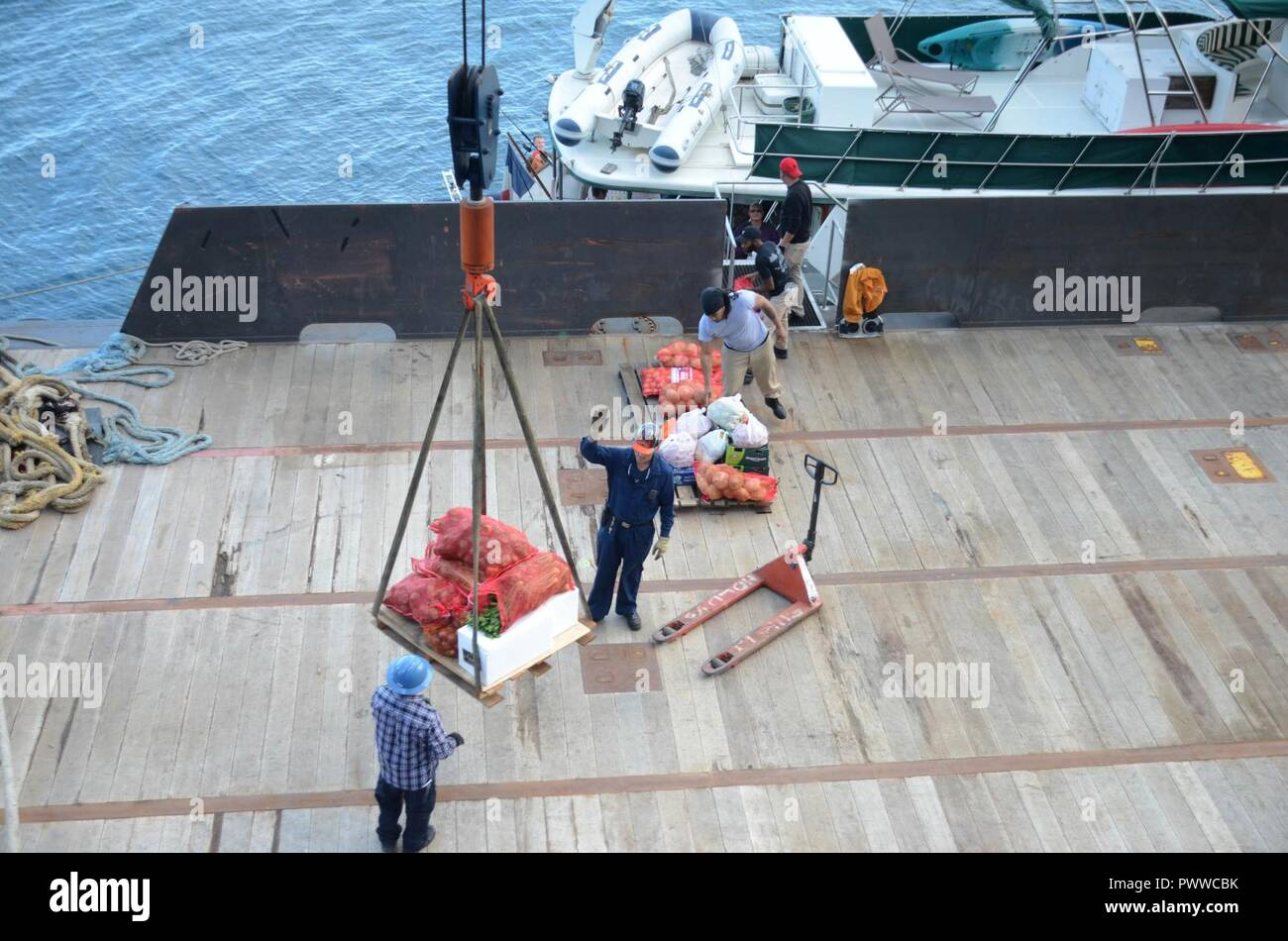 NOUMEA, New Caledonia (July 06, 2017) Civilian Mariners onboard USNS Sacagawea (T-AKE 2), onload stores and supplies off shore Noumea, New Caledonia in support of Koa Moana 17, July 6. Koa Moana 17 is designed to improve theater security, and conduct law enforcement and infantry training in the Pacific region in order to enhance interoperability with partner nations. ( Stock Photo