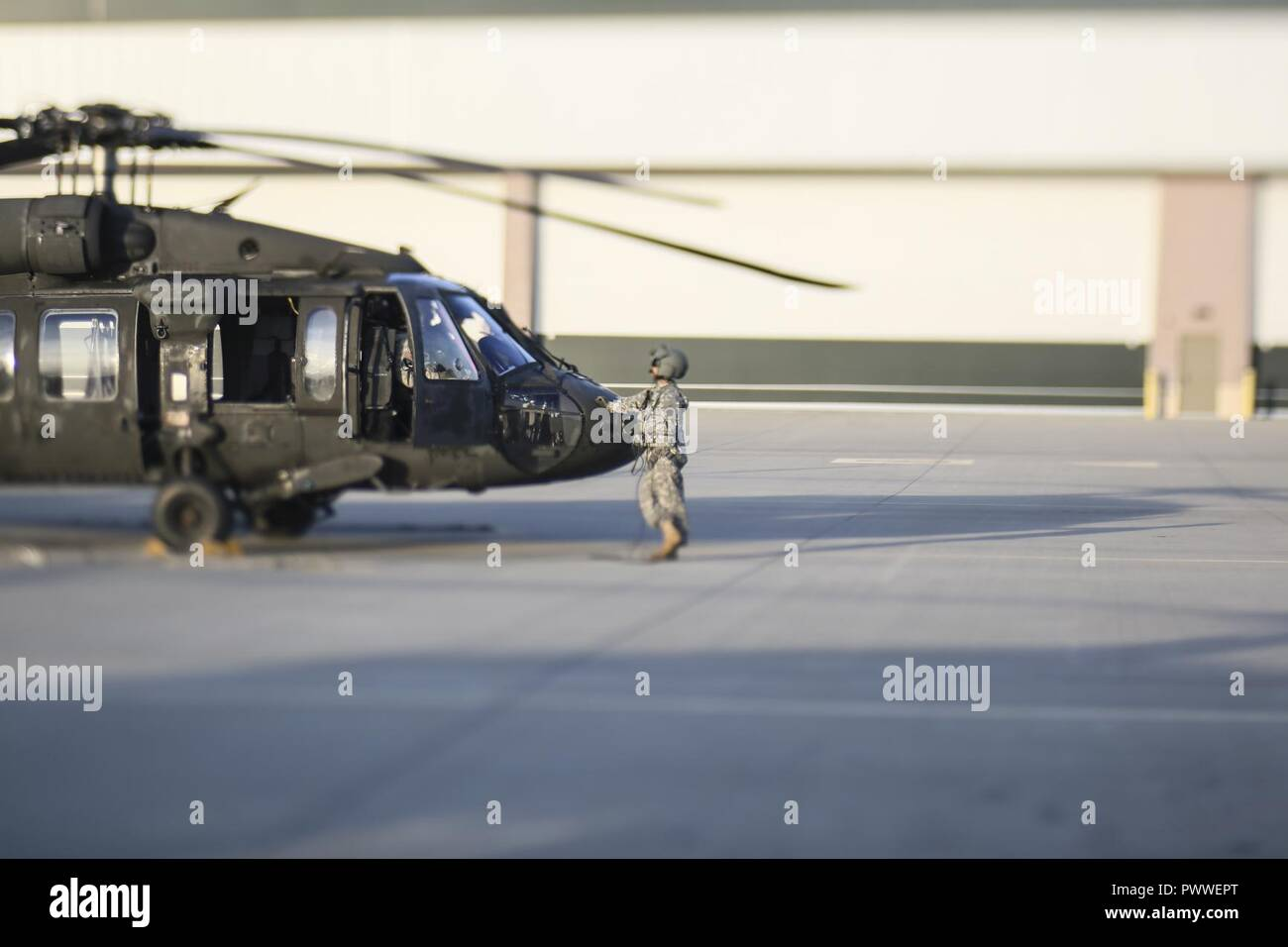 A 1-150th Assault Helicopter Battalion UH-60 Black Hawk helicopter crew  chief prepares for a training flight to Joint Base McGuire-Dix-Lakehurst 6d8131e4f