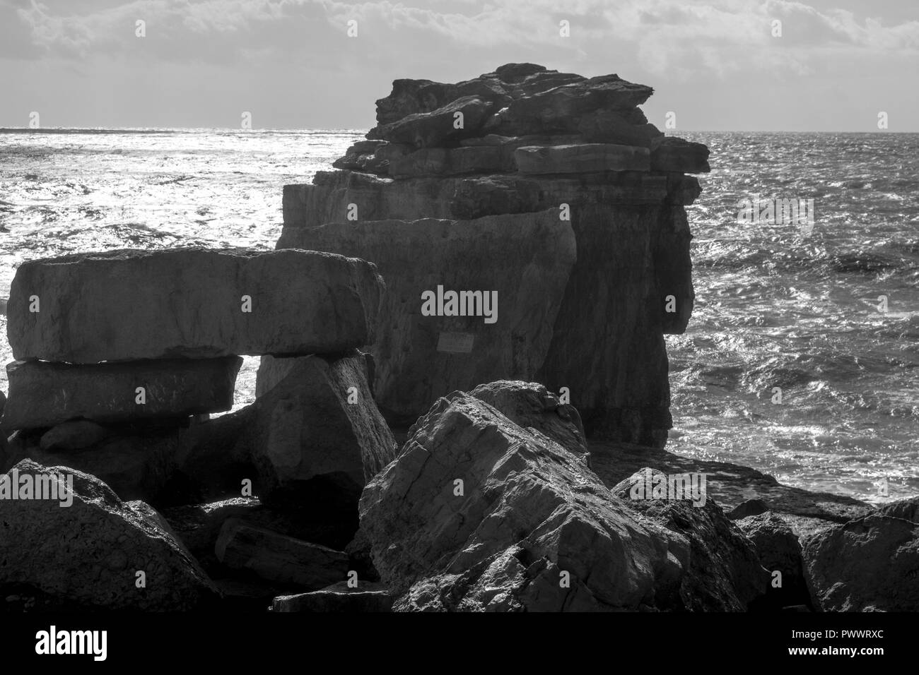 Pultpit  rock and  trinity monument Dorset  Portland bill - Stock Image
