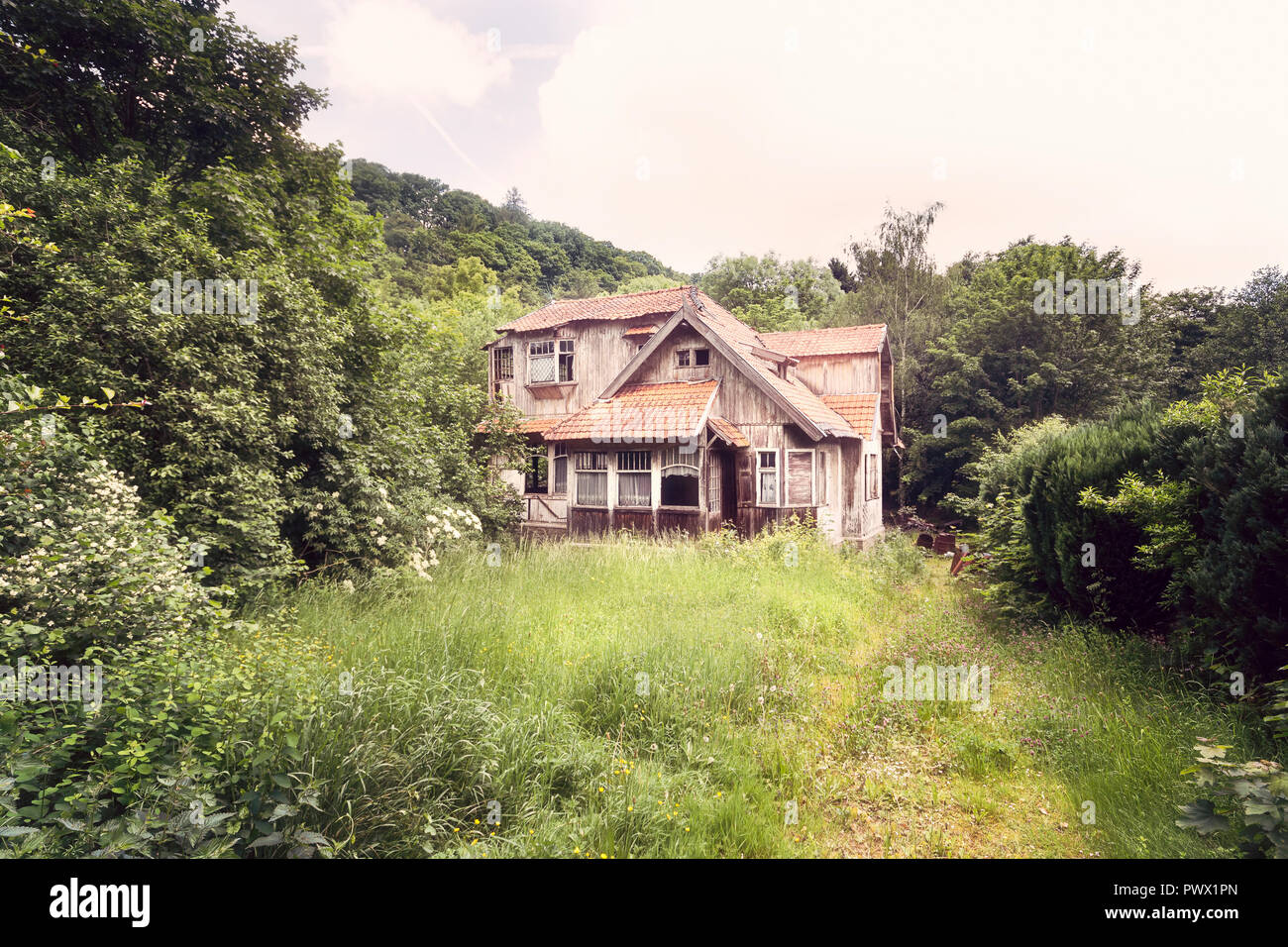 Exterior View From Overgrown Garden Of An Abandoned Wooden House In Spa Belgium Stock Photo Alamy