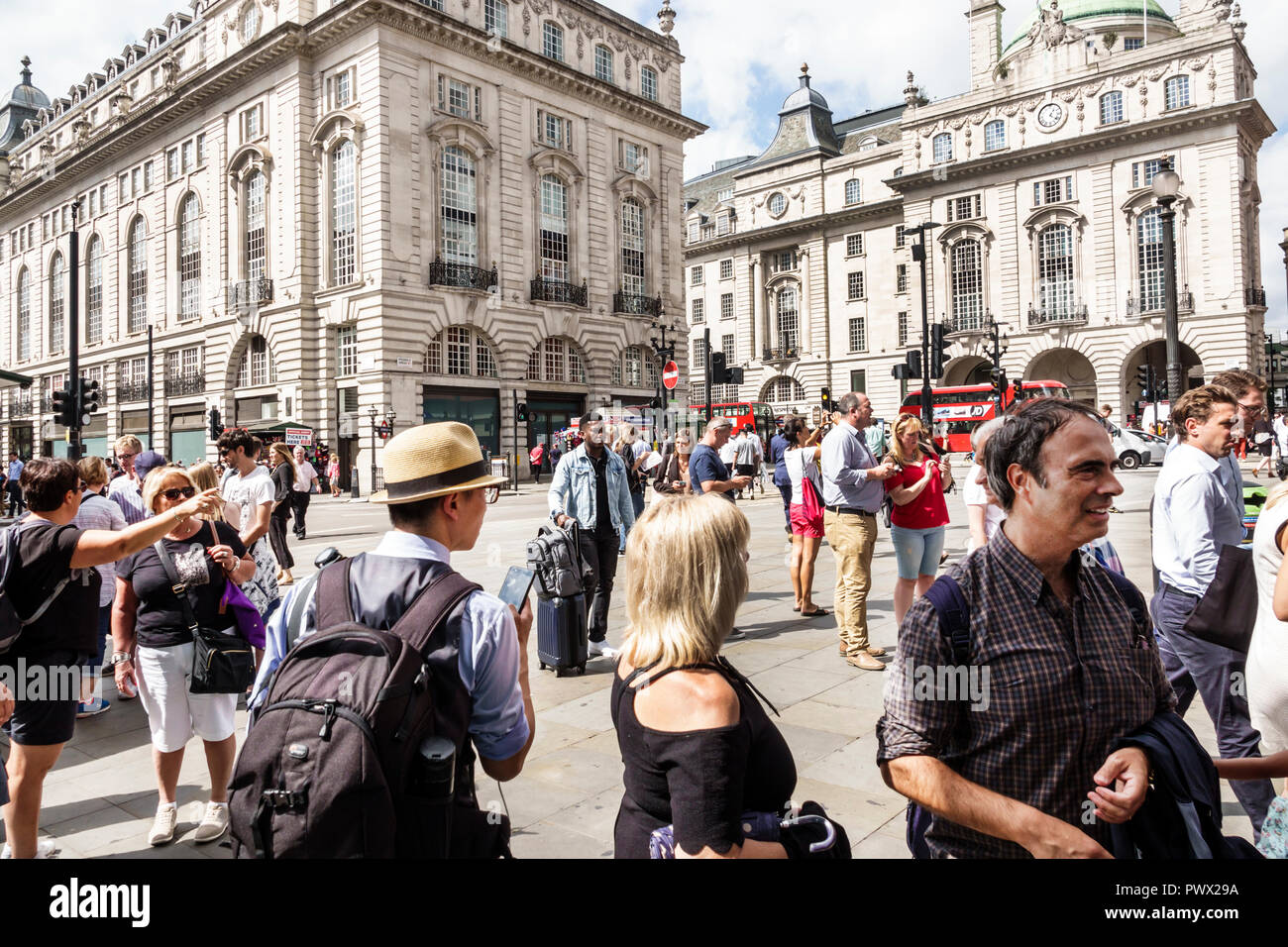 London England United Kingdom Great Britain West End Piccadilly Circus St. James's public space plaza Asian Black man woman crowd Swan & Edgar buildin - Stock Image