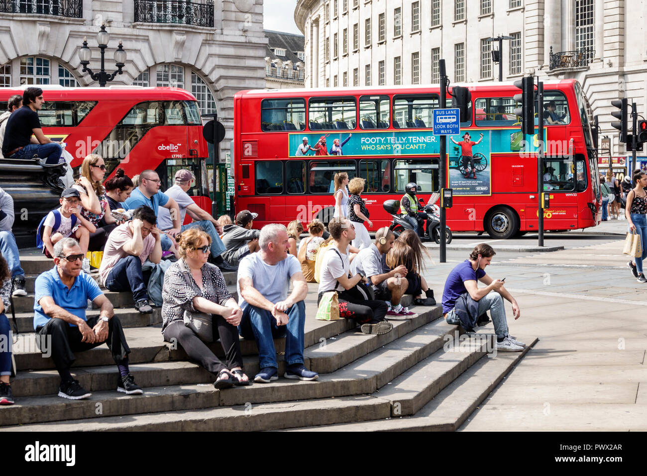 London England United Kingdom Great Britain West End Piccadilly Circus St Jamess Shaftesbury Memorial Fountain Steps Man Woman Boy Sitting Red Doubl