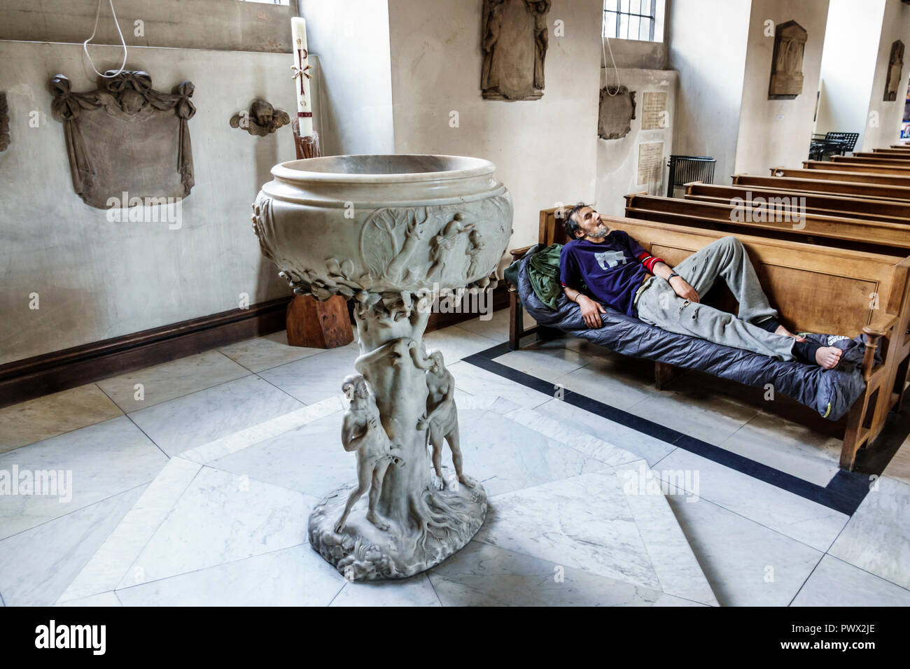 London England United Kingdom Great Britain West End St James's Piccadilly Church St James-in-the-Fields Anglican Church parish interior pews homeless Stock Photo