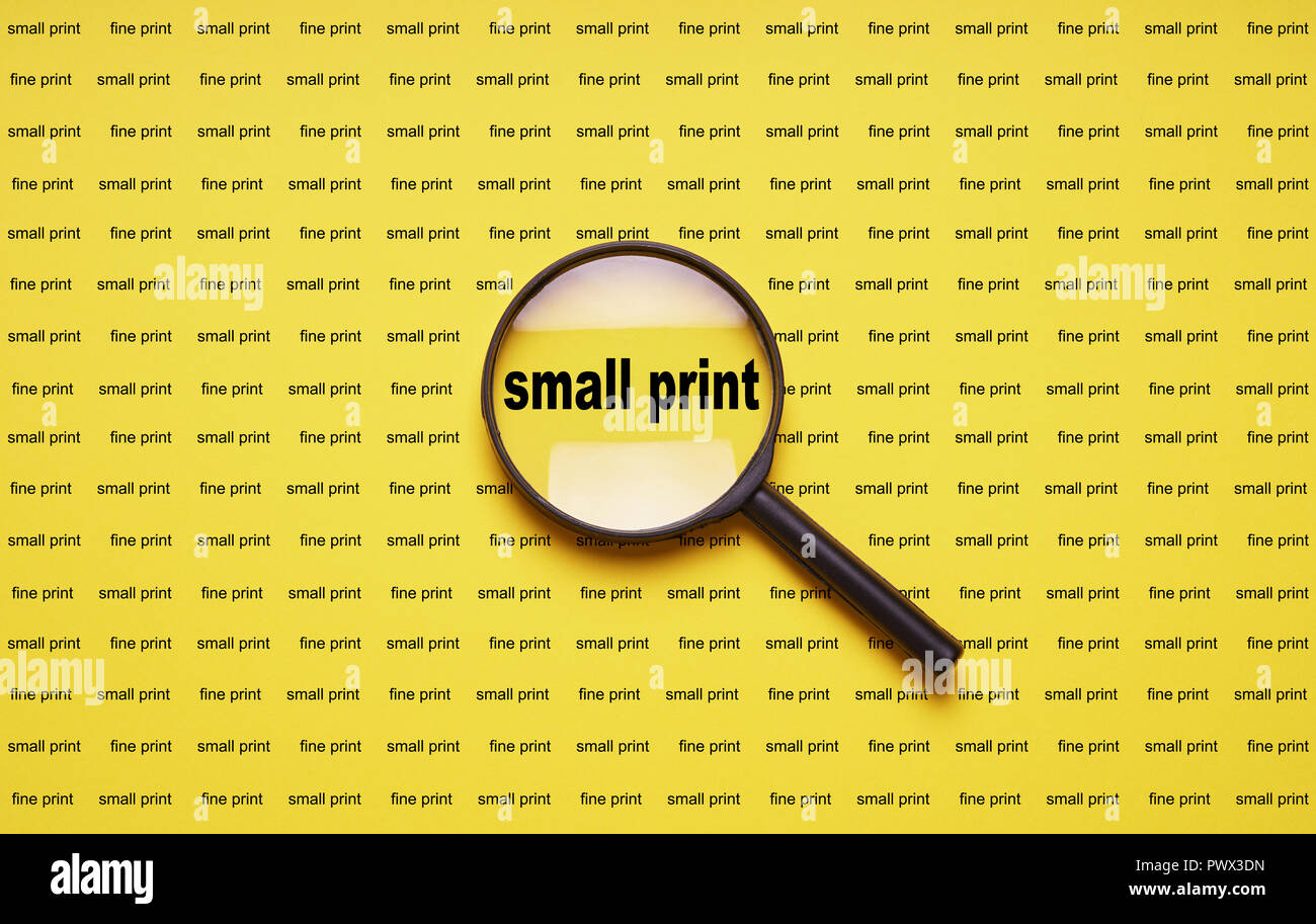 small print enlarged with magnifying glass magnifier loupe, business concept - Stock Image