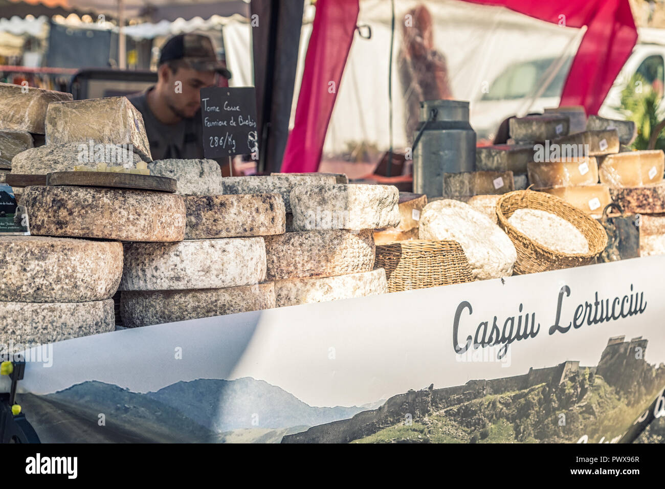 L'Ile Rousse, Corsica - 30th September 2018. Local cheeses are displayed for sale at an artisan fair in L'Ile Rousse in the Balagne region of Corsica - Stock Image