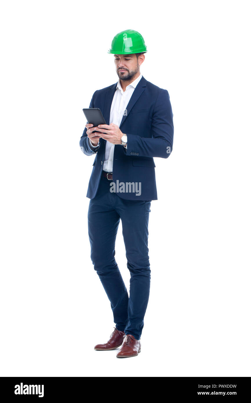 Young professional caucasian engineer in formal wear using digital tablet isolated on white - Stock Image