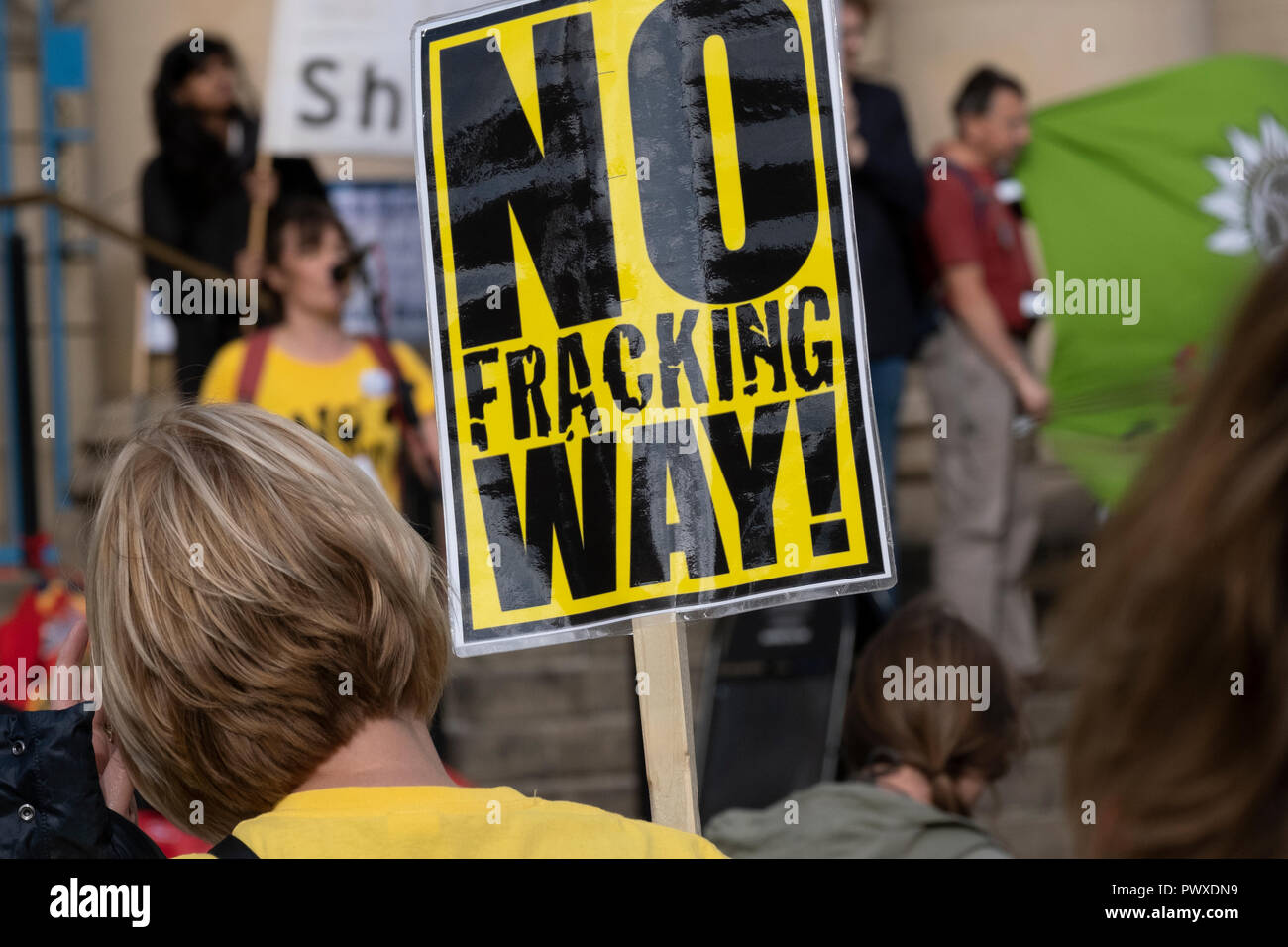 Fracking protest, peaceful protestor holding placard - Stock Image
