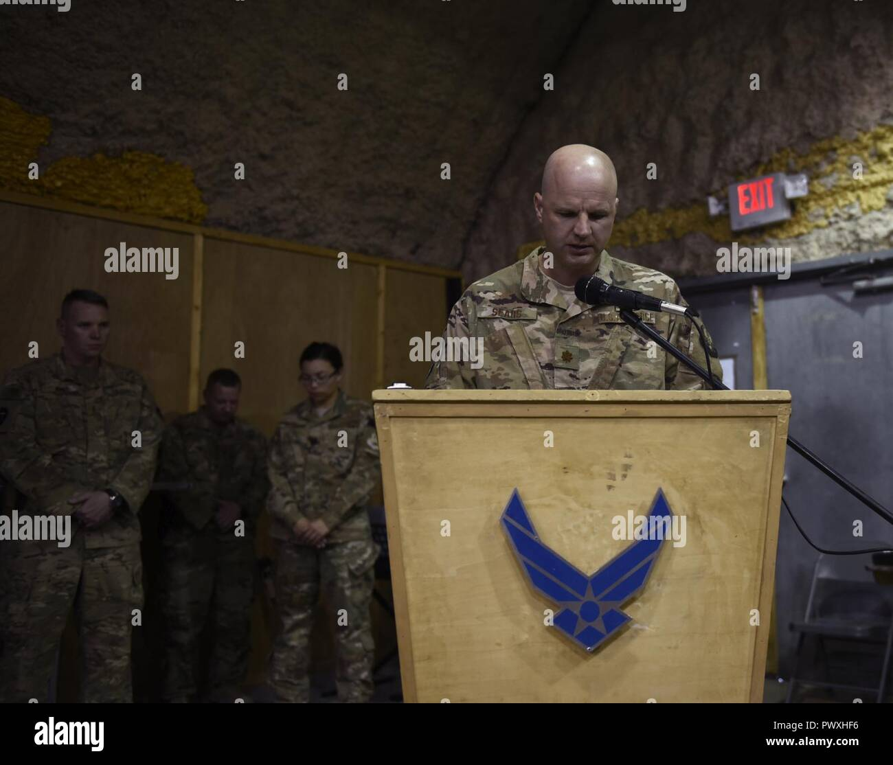 Chaplain (Maj.) Travis Sears, 451st Air Expeditionary Group, delivers an invocation during a ceremony at Kandahar Airfield, Afghanistan, June 23, 2017. Religious support teams from the 455th AEW provide spiritual support in seven locations in Afghanistan. Stock Photo