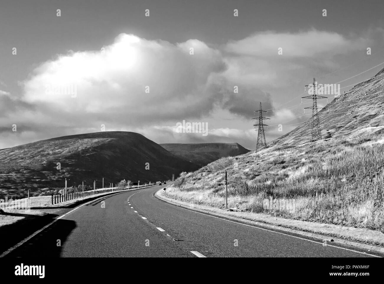 Intrusive roadside electricity pylons near the summit of Drumochter Pass on the A9 trunk road, Scottish Highlands, Scotland UK. - Stock Image