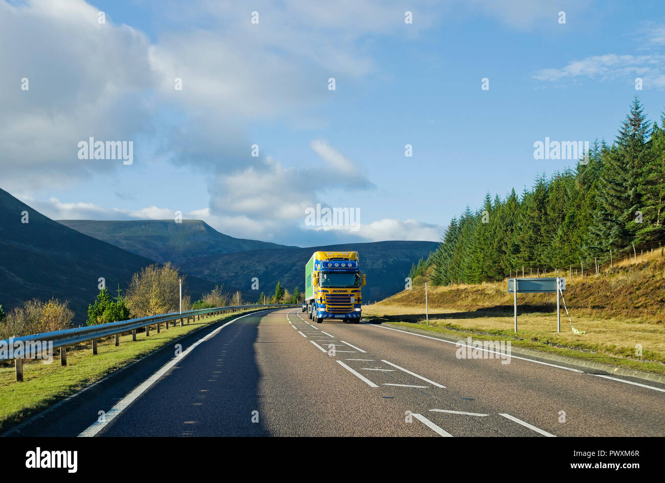HGV lorry travelling on A9 trunk road near the summit of Drumochter Pass on single carriageway stretch of road, Scottish Highlands, Scotland UK. - Stock Image