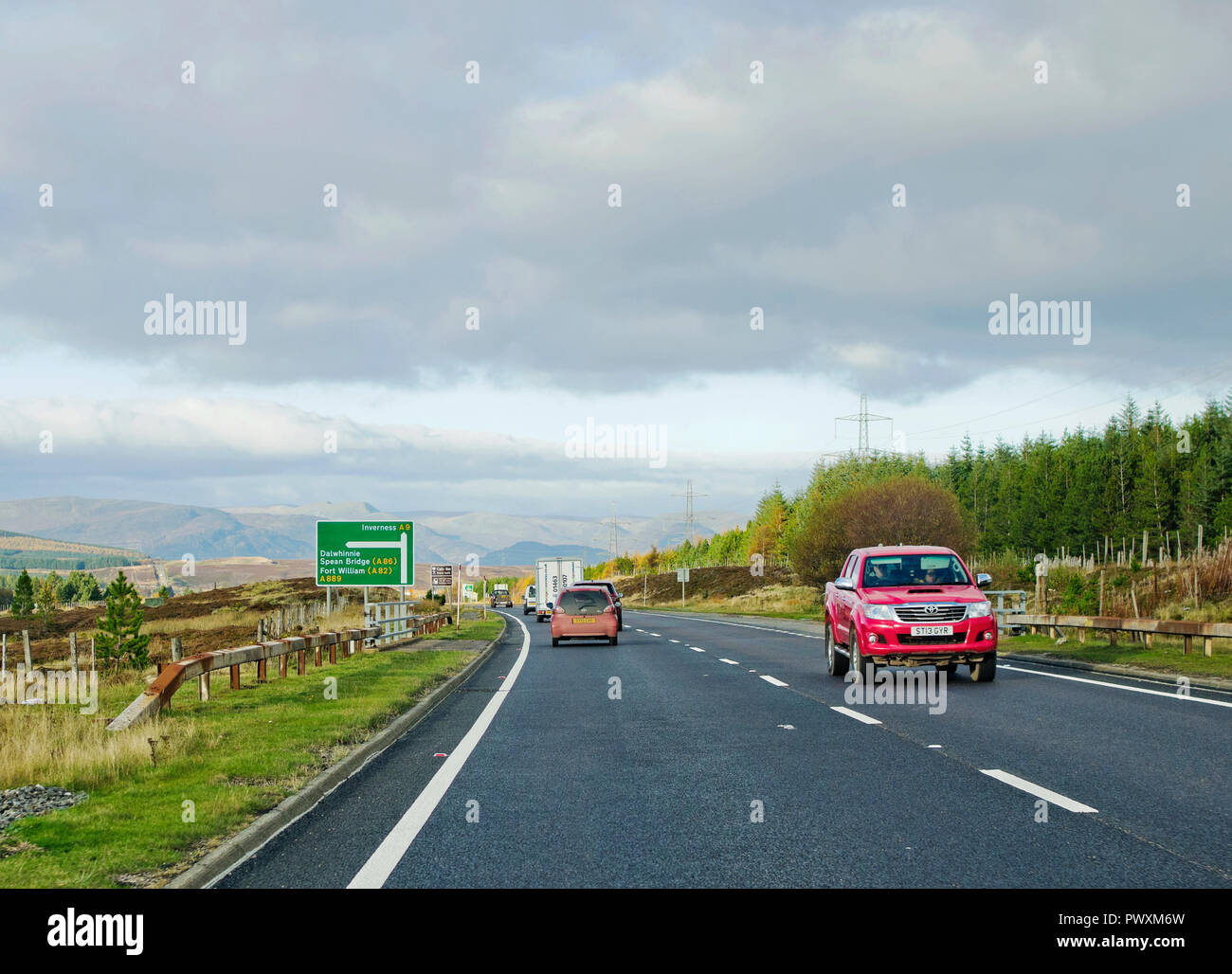 Traffic on single carriageway section of A9 trunk road approaching A889 Dalwhinnie road junction, Scottish Highlands Scotland UK. - Stock Image