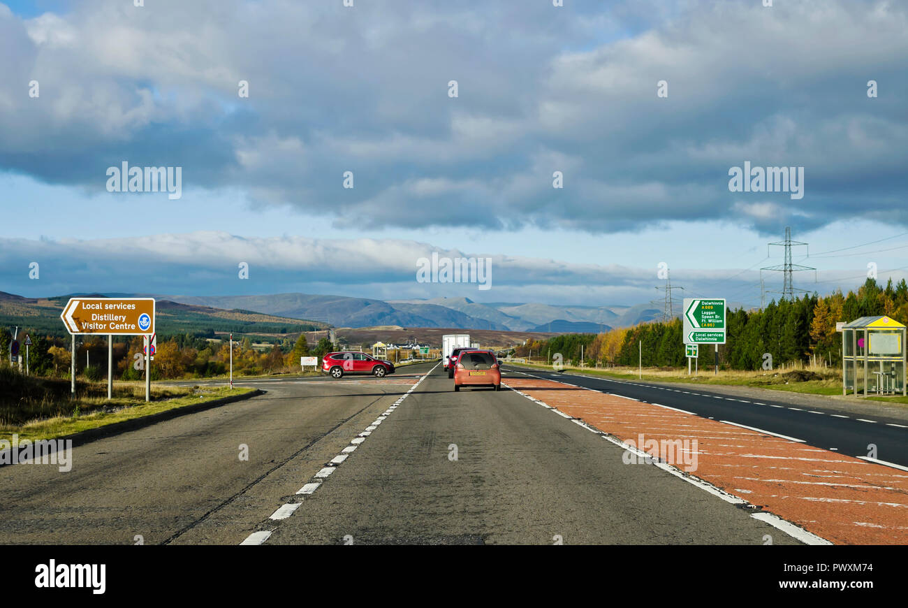 A9 trunk road, junction with A889 to Dalwhinnie, rural bus stop at roadside, mountains in background, Scottish Highlands, Scotland UK - Stock Image