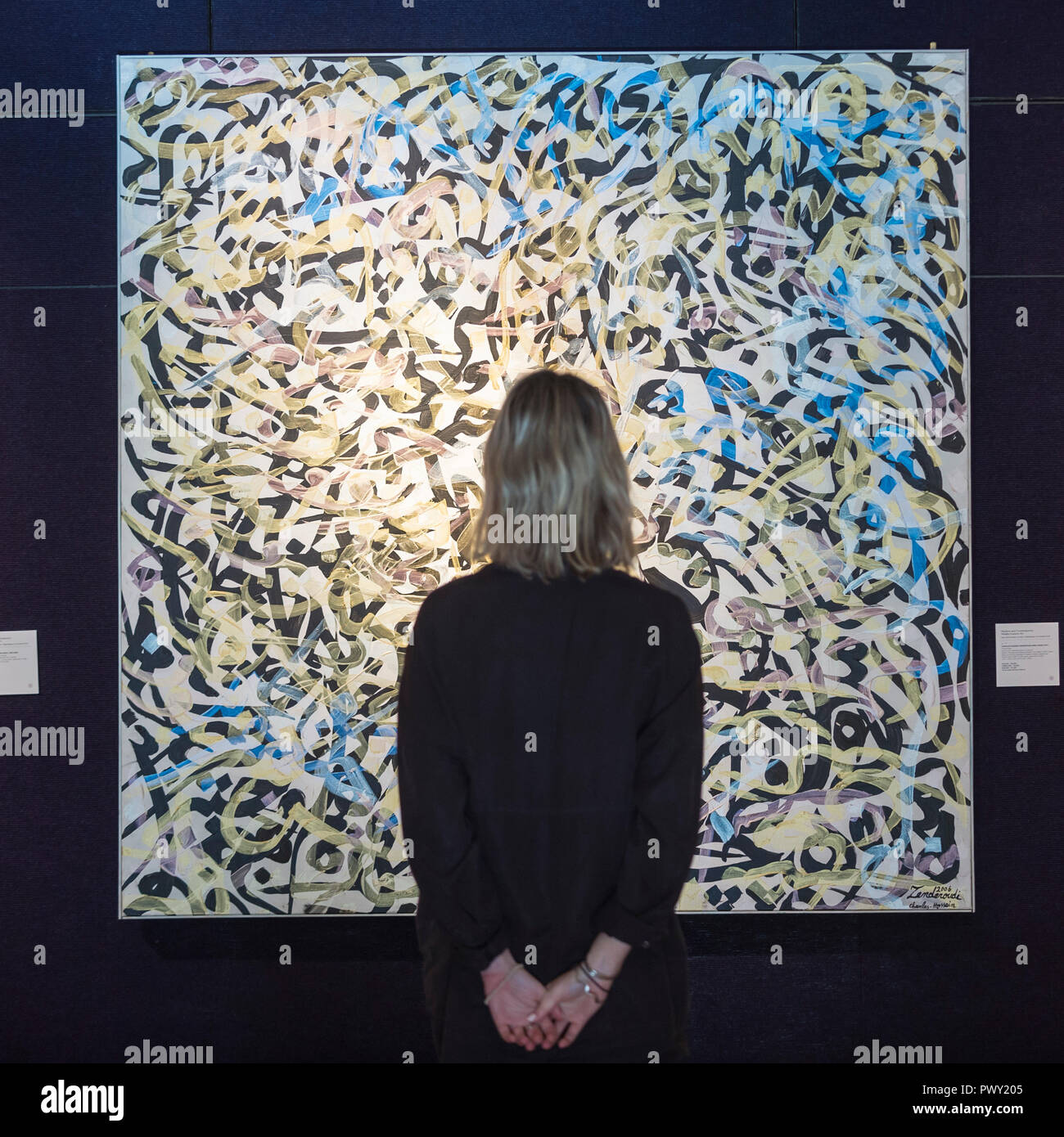 London, UK.  18 October 2018.  A staff member views 'Purple Pearl' by Charles Hossein Zenderoudi (Est. GBP40,000 to 60,000). Preview of Bonhams Asian Art Week which features works to be offered in the Islamic and Indian, Modern and Contemporary Middle Eastern art sale on 23 October and Modern and Contemporary South Asian art sale on 24 October.   Credit: Stephen Chung / Alamy Live News - Stock Image