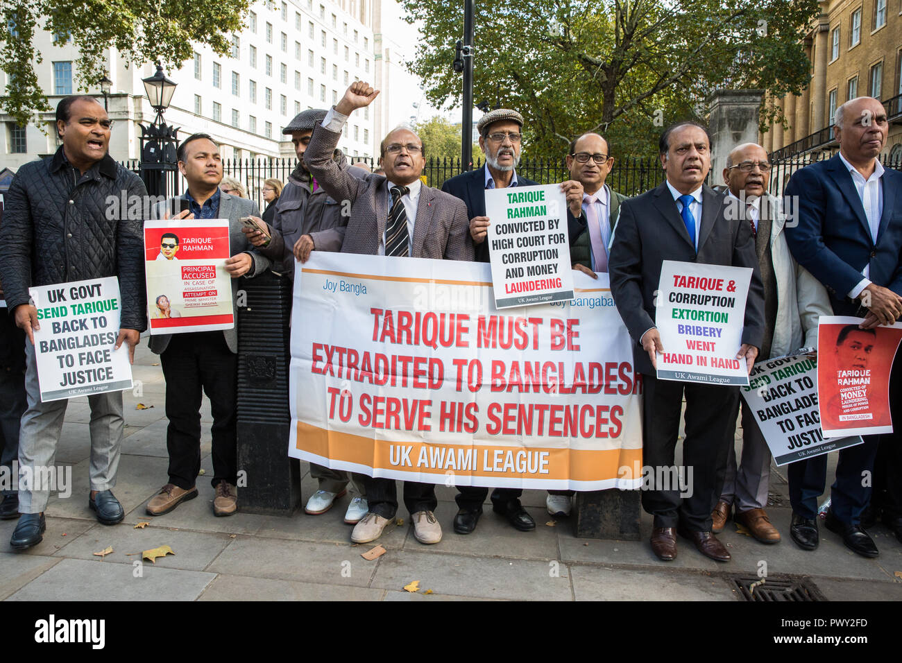 London, UK. 18th October, 2018. Campaigners from the UK Awami League, supporters of the current Government of Bangladesh under Prime Minister Sheikh Hasina, protest in Whitehall opposite Downing Street to call on the British Government to extradite Tarique Rahman, acting chairman of Bangladesh Nationalist Party, to Bangladesh. Tarique Rahman successfully applied for political asylum in the UK in 2008 and has since been granted indefinite leave to remain. Credit: Mark Kerrison/Alamy Live News Stock Photo