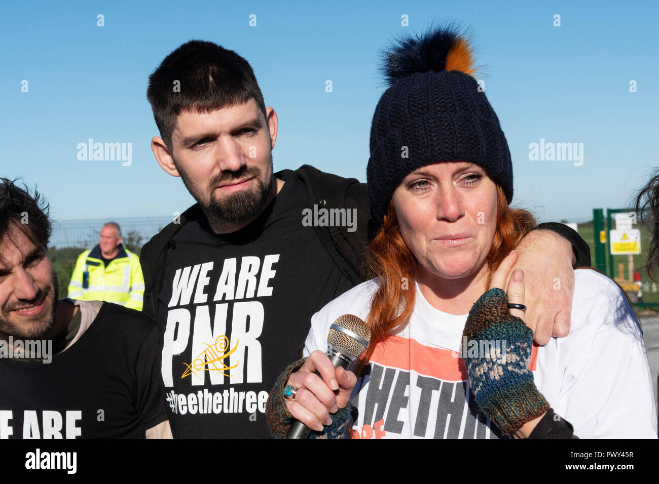 Blackpool. UK, 18th Oct. 2018. Three anti-fracking campaigners who were released from Preston jail after their successful appeal against their prison sentences visited the controversial Cuadrilla exploratory shale gas site and issued their press release to the gathered media. Supported by their partners they addressed the  crowd to explain why they will continue to campaign against fracking, their time in jail and the overwhelming support from fellow campaigners. Their partners also gave their thanks to fellow campaigners.  Credit: Dave Ellison/Alamy Live News - Stock Image