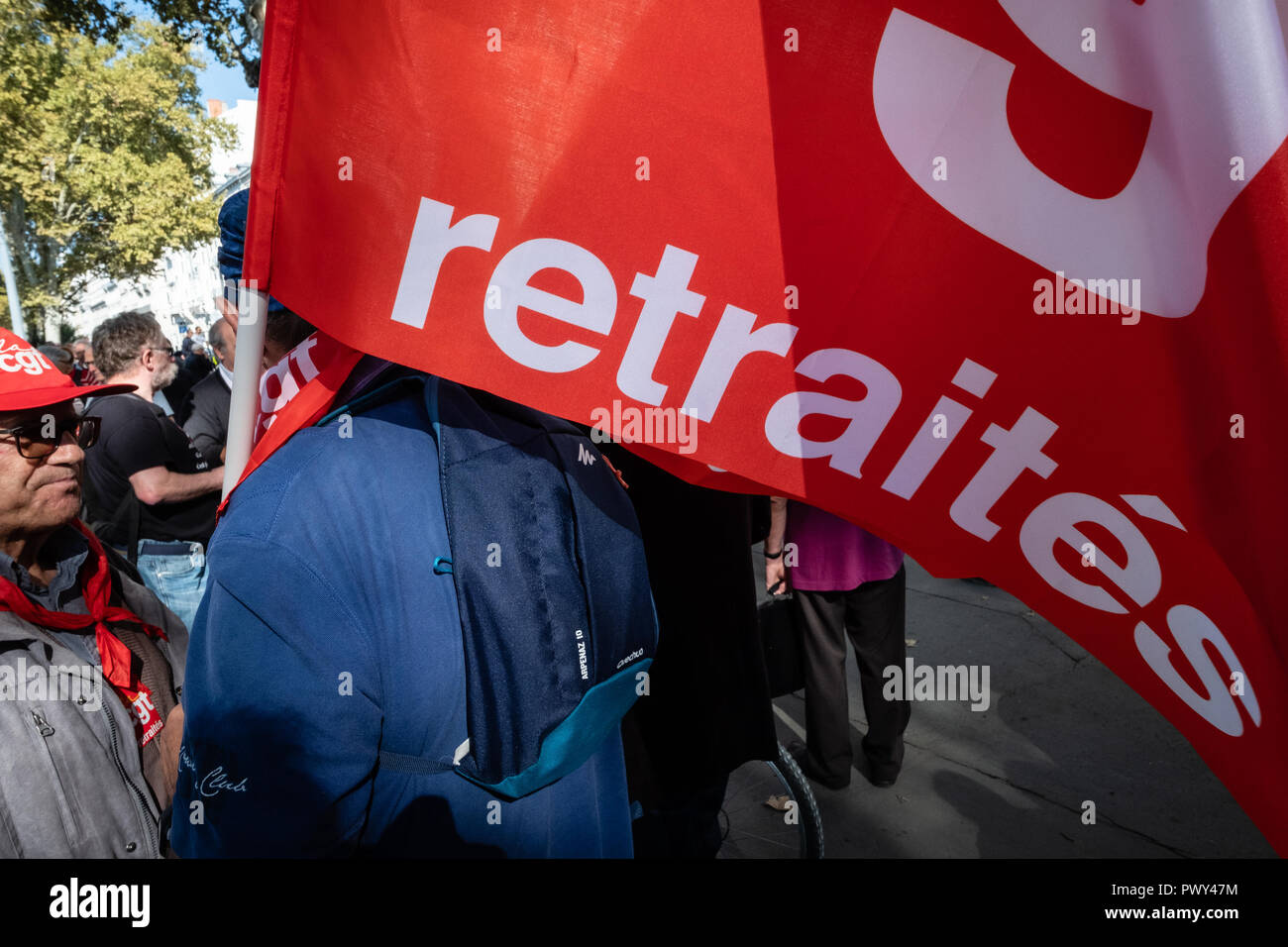 Lyon, France, 18th Oct Pensioners protest again the French government's plans to reform the pension and welfare system.  Red flags Credit: FRANCK CHAPOLARD/Alamy Live News - Stock Image