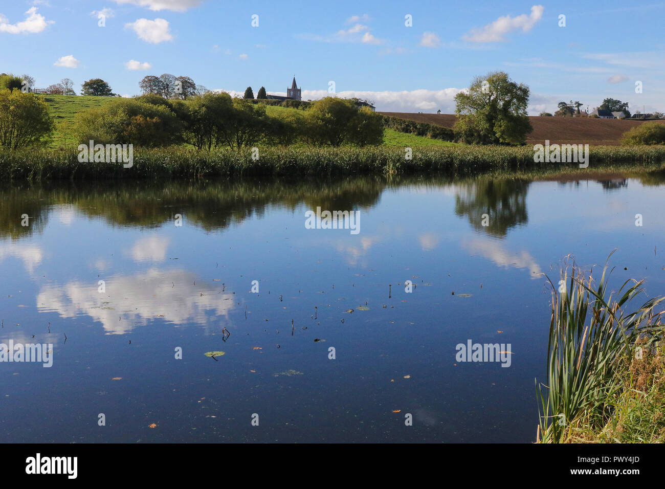 The Broadwater, Moira, Northern Ireland. 18 October 2018. UK weather - a glorious sunny day with lots of blue sky over Moira. High pressure dominates meaning little wind and great weather for out and about. Flat calm on the former Lagan Canal. Credit: David Hunter/Alamy Live News. - Stock Image