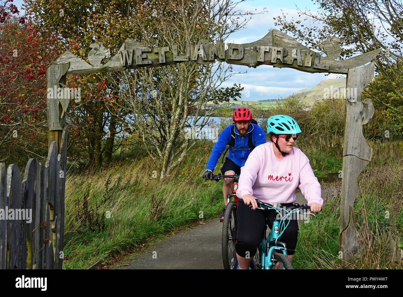 Kinross, Scotland, United Kingdom, 18, October, 2018. A couple cycle on the Loch Leven Heritage Trail on a fine autumn day. © Ken Jack / Alamy Live News - Stock Image