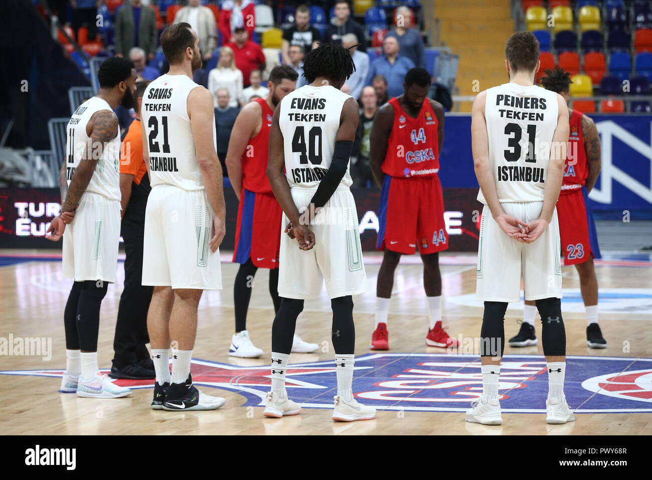 ATTENTION EDITORS! INACCURATE PLACENAME AND DATE IN CAPTIONS FOR TASS IMAGES DATED OCTOBER 2018, TITLED '2018/2019 Euroleague: CSKA Moscow vs Darussafaka Tekfen Istanbul'; CORRECT PLACENAME IS MOSCOW, CORRECT DATE IS 18 OCTOBER 2018. EXAMPLE OF CORRECT CAPTION FOLLOWS: 'MOSCOW, RUSSIA - OCTOBER 18, 2018: Darussafaka Tekfen Istanbul's Stanton Kidd, Oguz Savas, Jeremy Evans, Zanis Peiners (L-R front), and CSKA Moscow players observe a minute of silence in memory of the victims of the October 2018 Kerch school shooting, before the start of a 2018/2019 Euroleague Regular Season Round 3 basketball - Stock Image