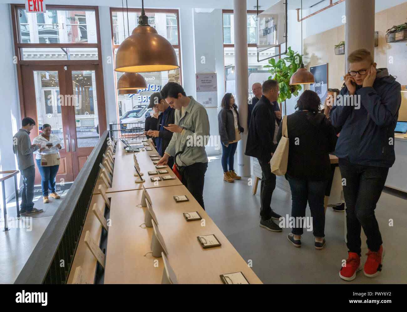 Visitors try out Google products in the Google Hardware