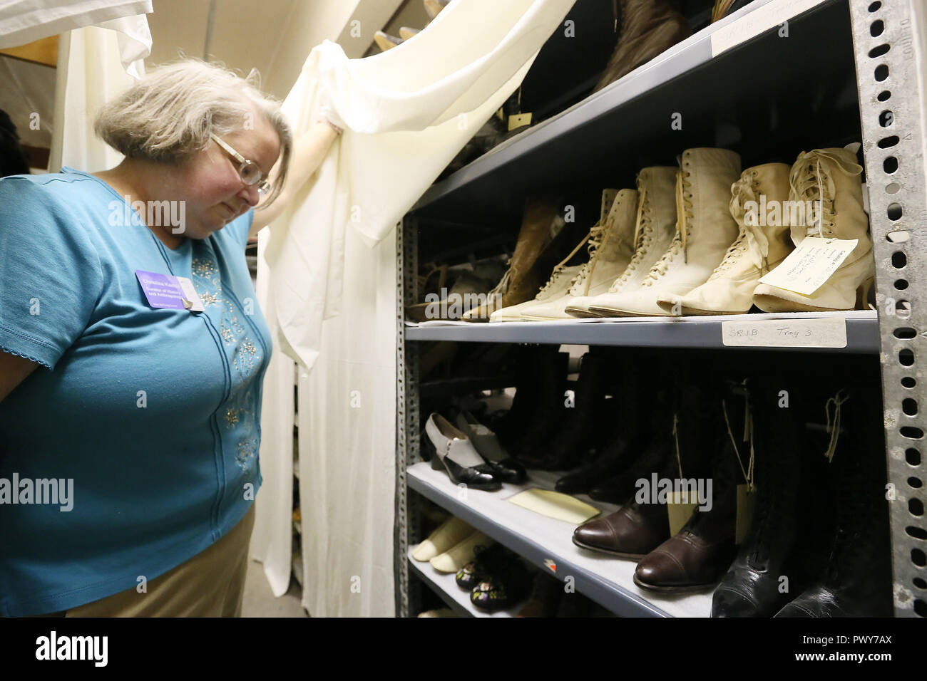 Davenport, Iowa, USA. 10th Sep, 2018. Christina Kastell, curator of history anthropology at the Putnam Museum looks over the collection of shoes from various era's that are part of the museum's costume collection. Pointed toed shoes were common for women. Credit: Kevin E. Schmidt/Quad-City Times/Quad-City Times/ZUMA Wire/Alamy Live News - Stock Image