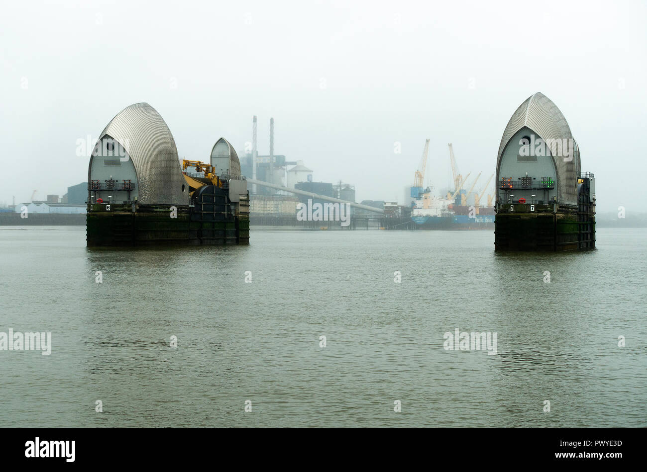 The Thames Barrier Flood Defences in the River Thames near Greenwich and Silvertown Greater London England United Kingdom - Stock Image