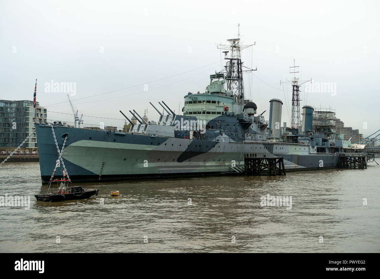 The World War Two Light Cruiser HMS Belfast a Floating Museum Moored in River Thames near Tower Bridge London England United Kingdom UK Stock Photo