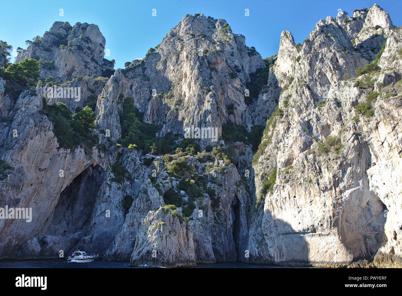 jagged rock formations on capri - Stock Image