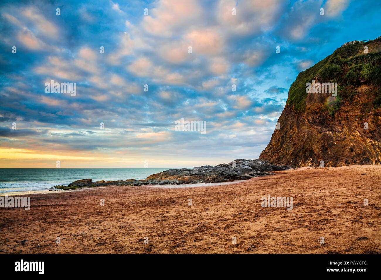 Sunset over the beach at Tresaith in Ceredigion, Wales. Stock Photo