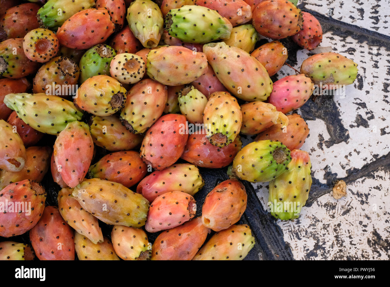 Prickly pear cactus fruit on a street in Trani, Puglia, Italy. They have just been washed by a street seller. - Stock Image