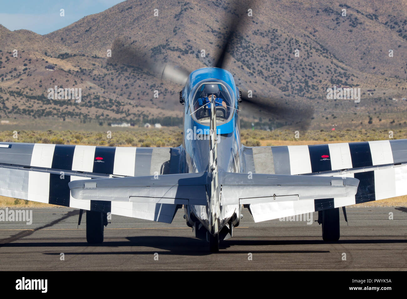 P-51 Mustang and Unlimited Air Racer 'Lady B' prepares to taxi on the ramp prior to a heat race at the 2018 Reno National Championship Air Races. - Stock Image