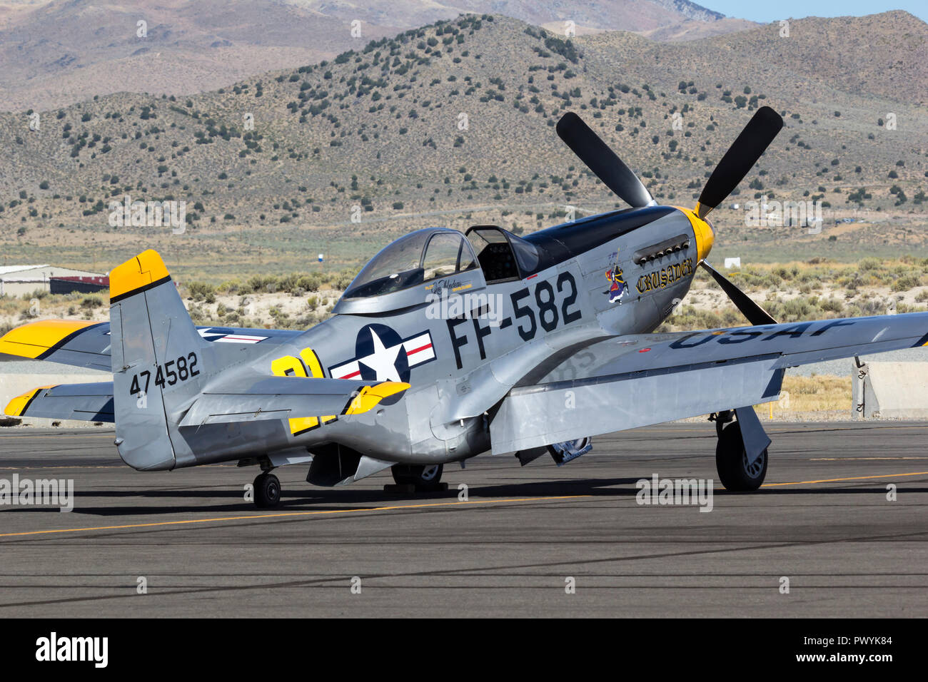 P-51 Mustang and Unlimited Air Racer 'Crusader' sits on the ramp prior to a heat race during the 2018 Reno National Championship Air Races. - Stock Image
