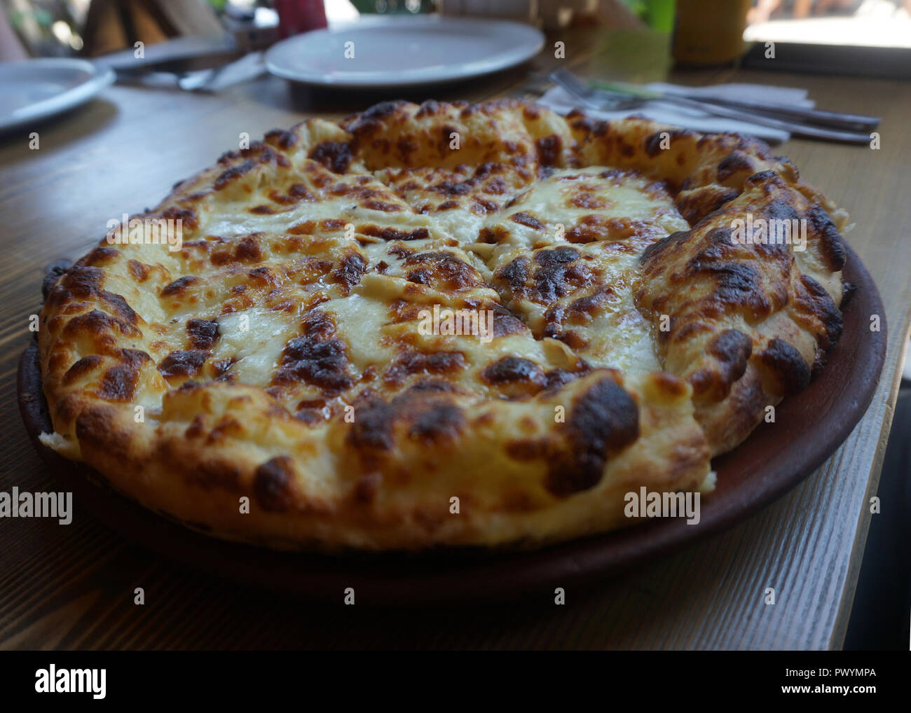 Georgian Traditional Khachapuri Megruli Topped With Cheese And Butter Stock Photo Alamy