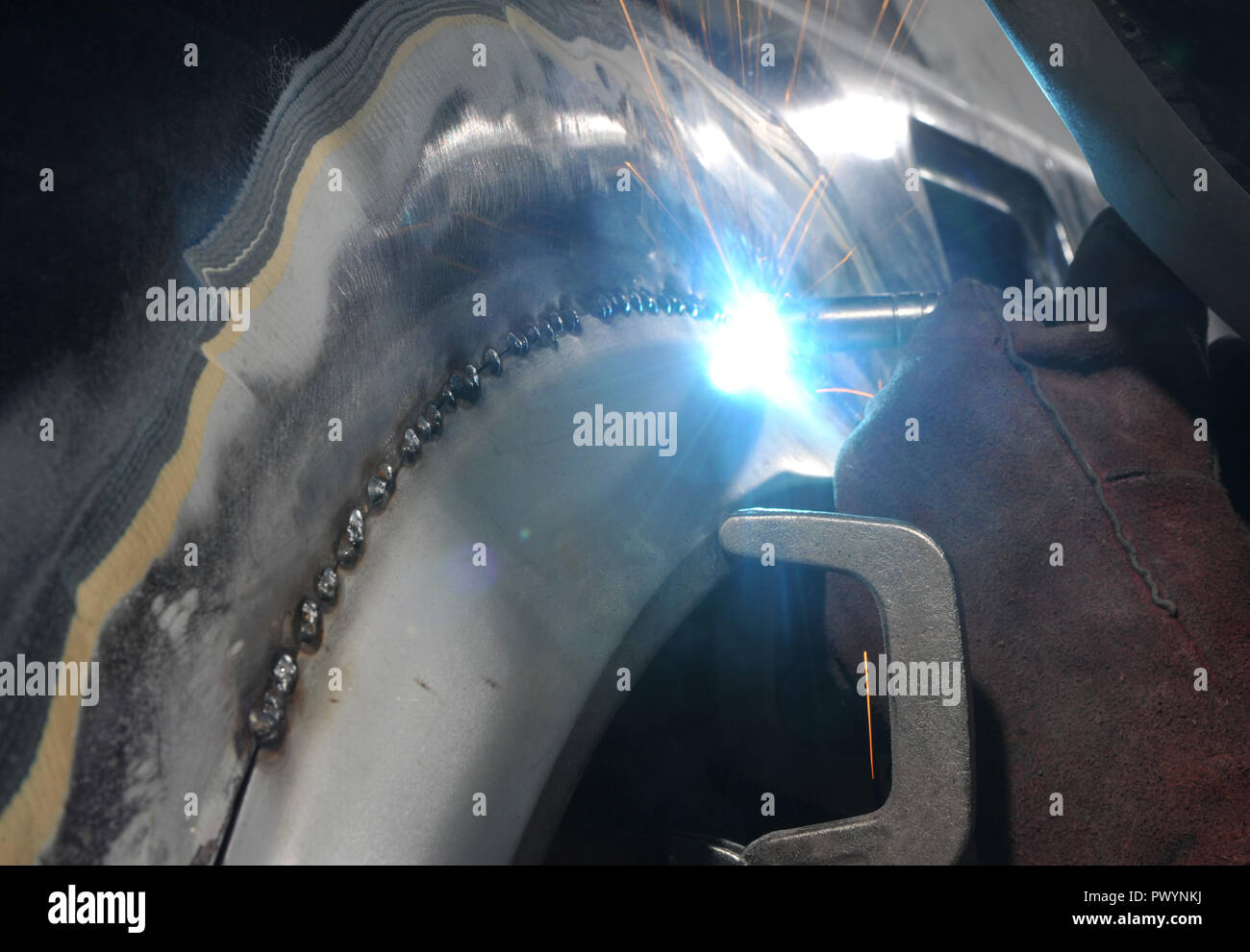 MIG Welding repairs to a Mk1 MR2 classic car - Stock Image