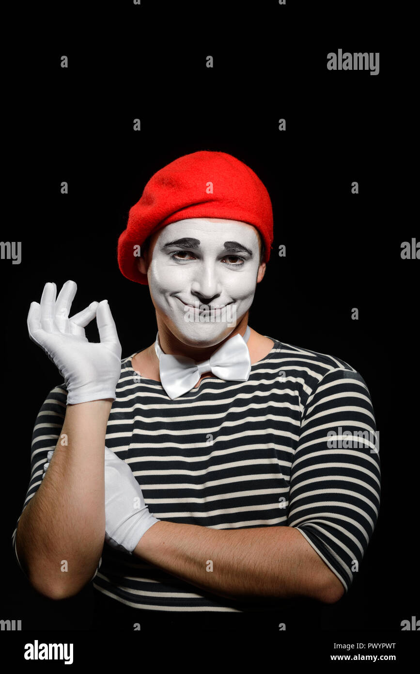 Portrait of smiling male mime - Stock Image